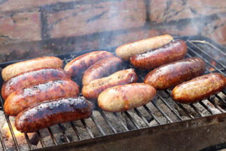 BBQ Value Pack Two displaying sausages on a grill